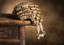 Barristers wig on a wooden desk