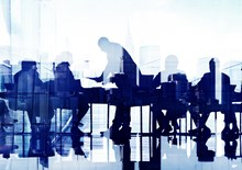 Business professionals at a meeting by a large window