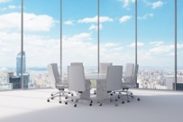 Meeting table and chairs in a bright room with a view