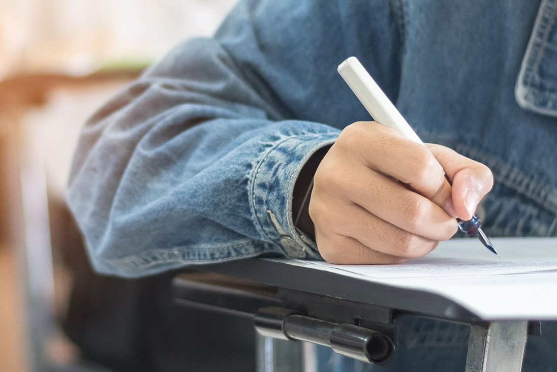 Student taking a written exam