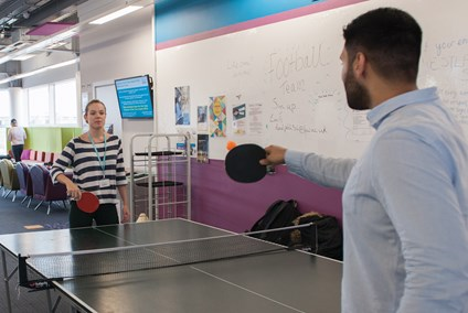 Two students playing table tennis