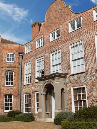 Sunny exterior of Earlham hall at the University of East Anglia