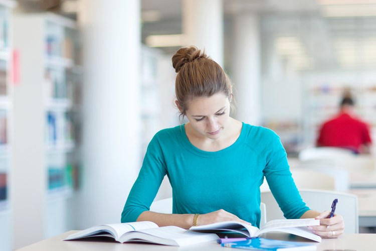 Student studying in library area