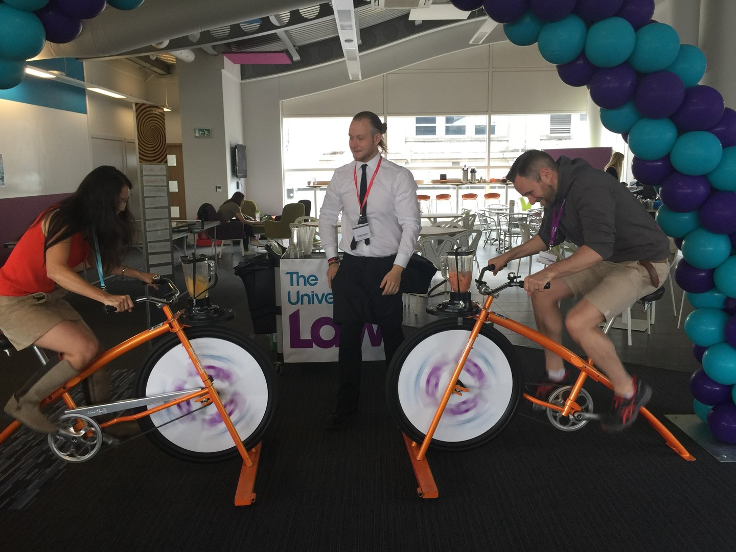University of Law Leeds students compete on a smoothie bike challenge during Wellbeing Week